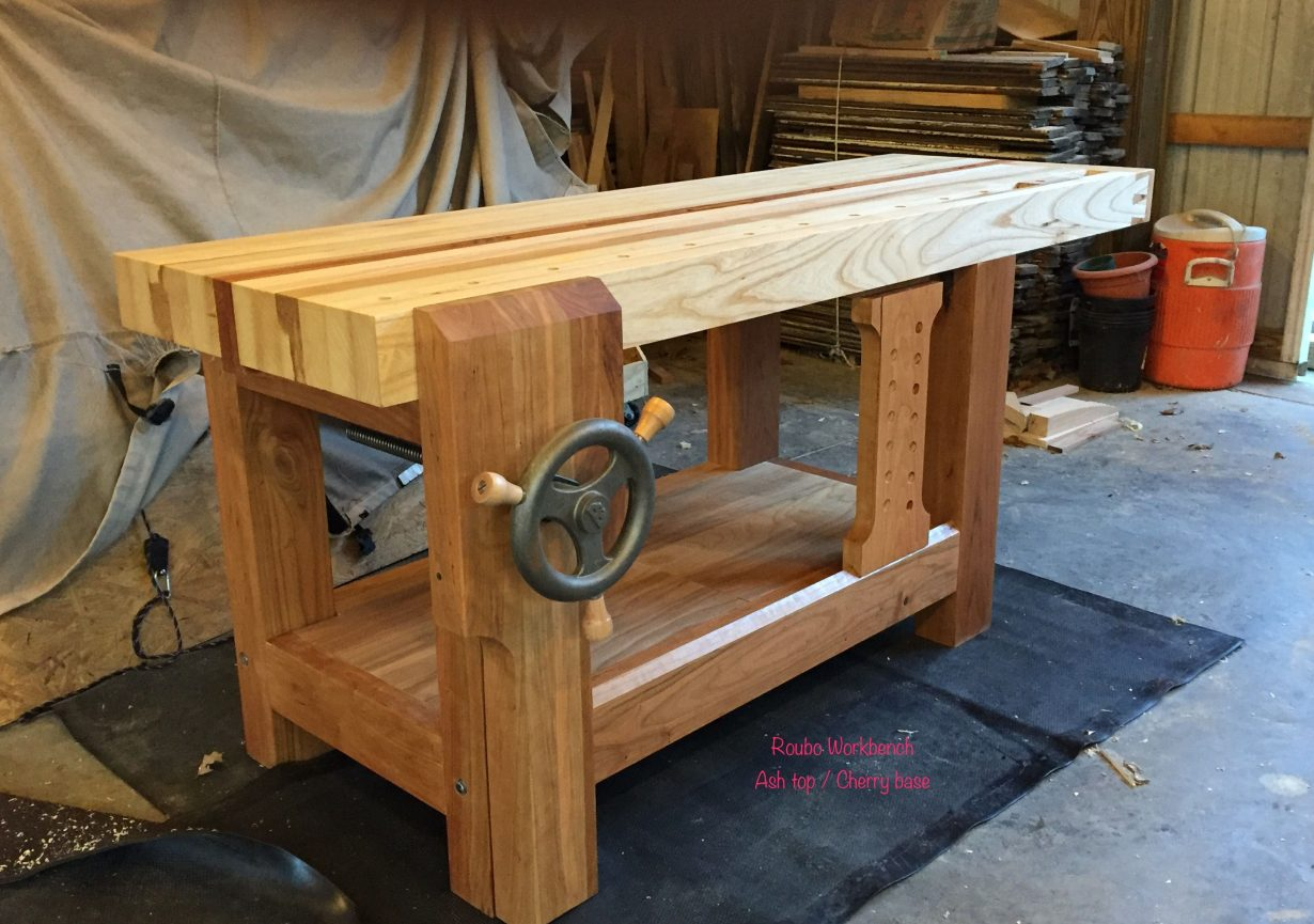 A wooden bench sitting on top of a table