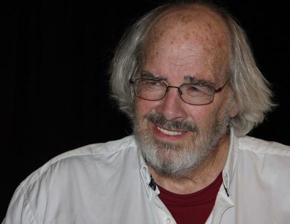 Jack Horner wearing glasses and looking at the camera