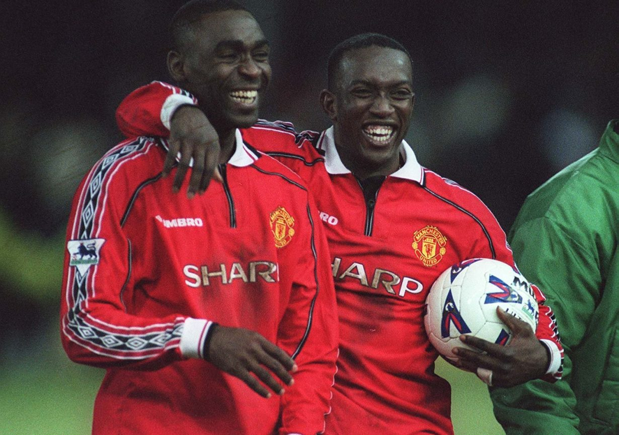 Andy Cole, Dwight Yorke are posing for a picture