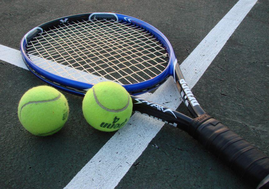 A basket ball court holding a racquet