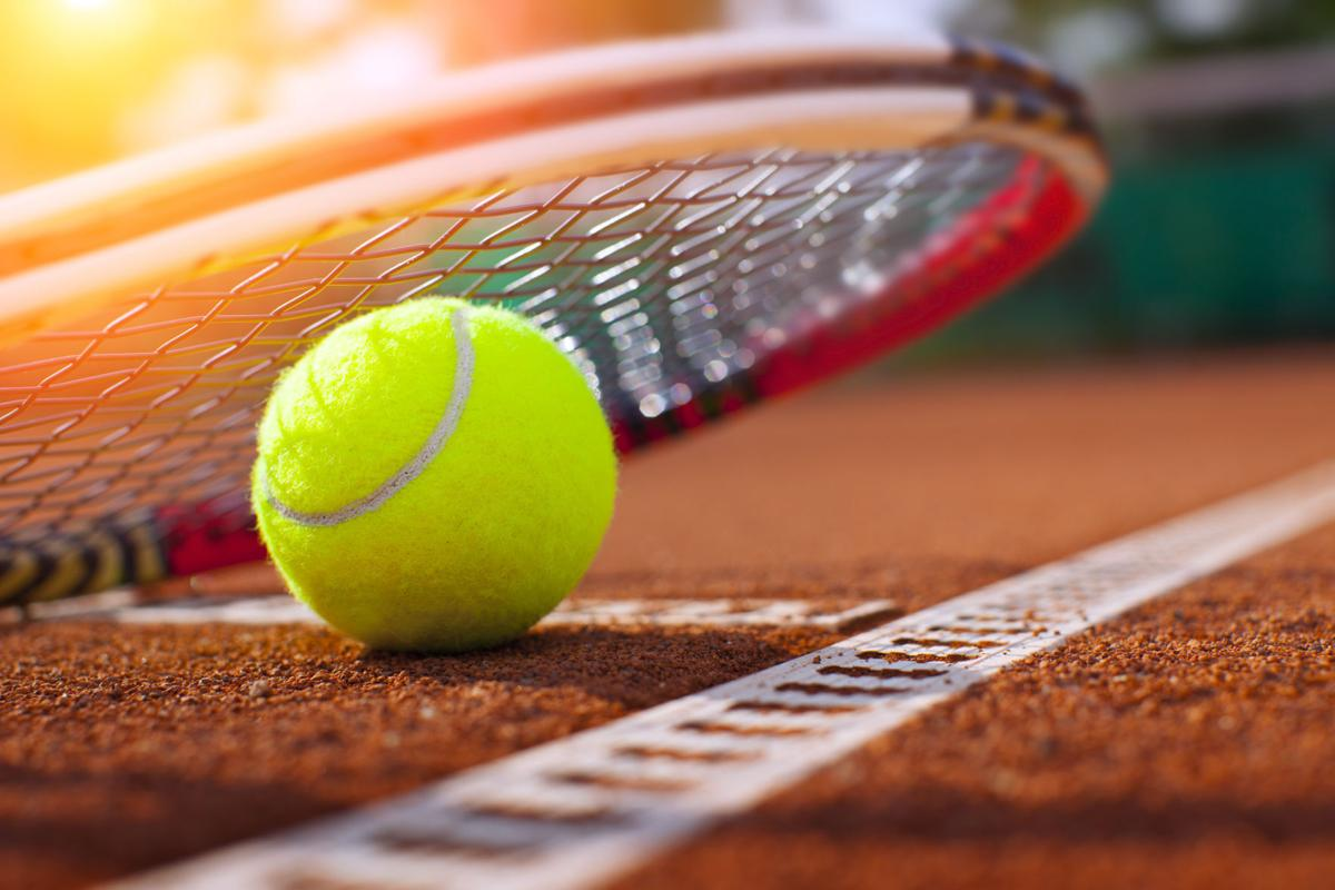 A close up of a ball with a racket
